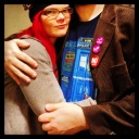 JoEllen hugging a tall man in a Dr. Who t-shirt, the man's face is not visible